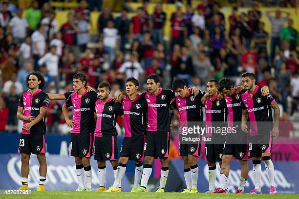 Players of Atlas stay together during the penalty series during a Quarterfinals match between Atlas and Puebla as part of Copa MX Apertura 2014 at...