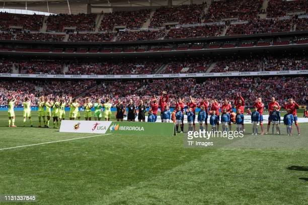Players of Atletico de Madrid and Barcelona gesture prior to the Liga Iberdrola match between Atletico de Madrid and Barcelona at Wanda Metropolitano...