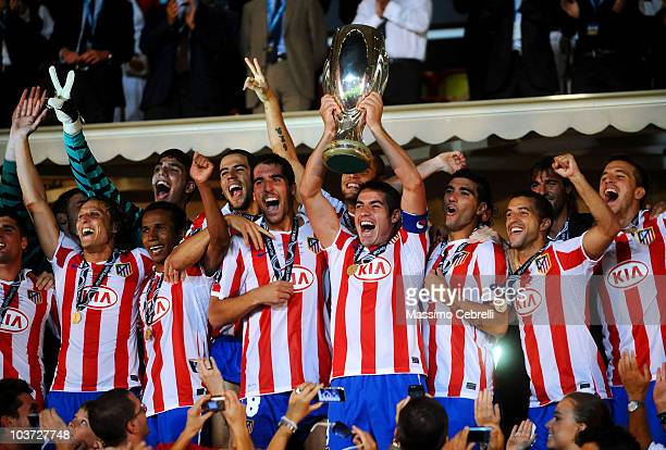 Players of Atletico de Madrid celebrate victory with the trophy after the UEFA Super Cup match between FC Inter Milan and Atletico de Madrid at Louis...