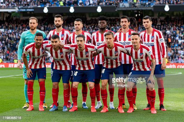 Players of Atletico de Madrid pose for a team photo prior to the Liga match between Real Madrid CF and Club Atletico de Madrid at Estadio Santiago...