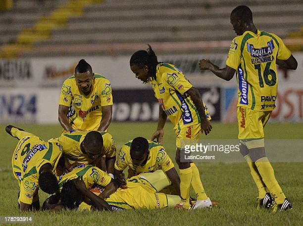 Players of Atletico Huila celebrate a scored goal against Deportes Tolima during a match between Atletico Huila and Deportes Tolima as part of the...