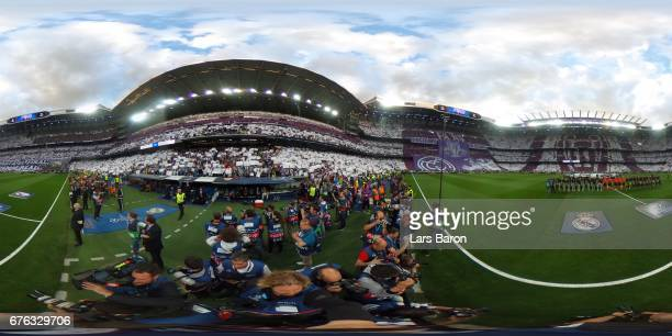 Players of Atletico Madrid and Real Madrid walk onto the pitch ahead of the UEFA Champions League semi final first leg match between Real Madrid CF...