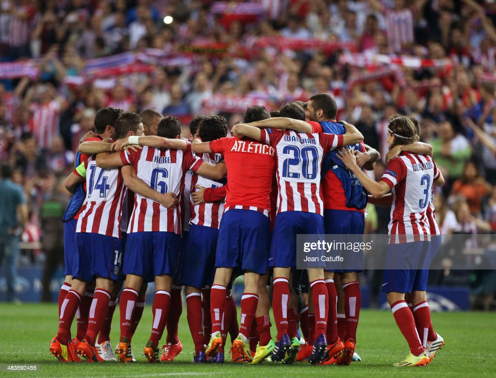 Players of Atletico Madrid celebrate the victory after the UEFA Champions League quarter final match between Club Atletico de Madrid and FC Barcelona at Vicente Calderon stadium on April 9, 2014 in Madrid, Spain.