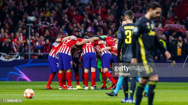 Players of Atletico Madrid form a circle during the UEFA Champions League Round of 16 First Leg match between Club Atletico de Madrid and Juventus at...