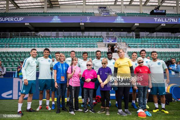 TALLINN ESTONIA AUGUST Players of Atletico Madrid greet kids of the UEFA Foundation ahead of Atletico Madrid's training session ahead of the UEFA...