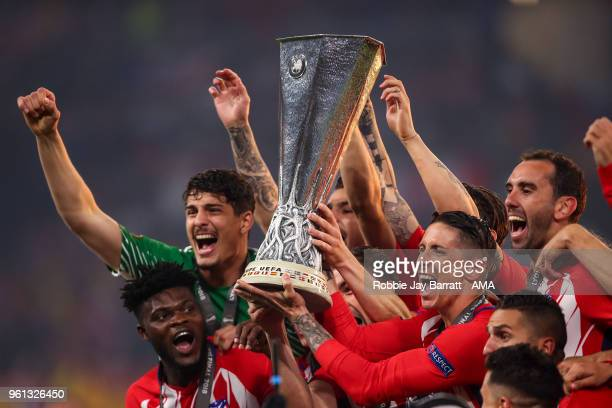 Players of Atletico Madrid lift the UEFA Europa League trophy during the UEFA Europa League Final between Olympique de Marseille and Club Atletico de...