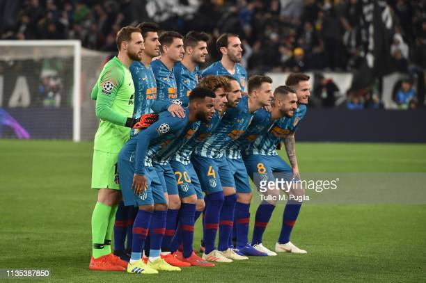 Players of Atletico Madrid pose for a team shot during the UEFA Champions League Round of 16 Second Leg match between Juventus and Club de Atletico...