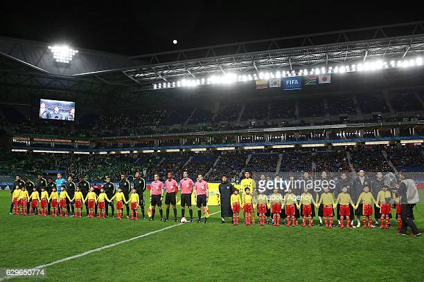 Players of Atletico Nacional and Kashima Antlers lineup during the semi final match between Atletico Nacional and Kashima Antlers as part of the FIFA...