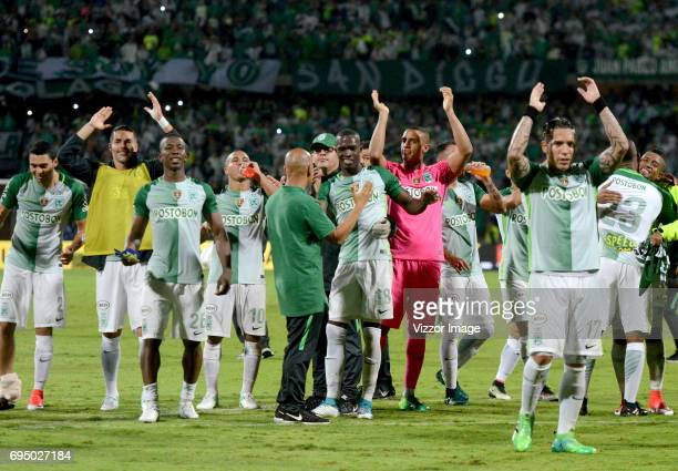 Players of Atletico Nacional celebrate after winning the semi finals second leg match between Atletico Nacional and Millonarios as part of the of the...