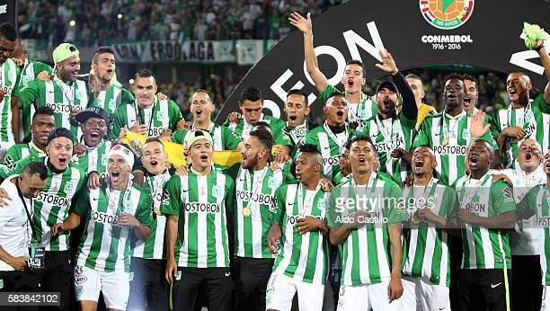 Players of Atletico Nacional celebrate the championship after a second leg final match between Atletico Nacional and Independiente del Valle as part...