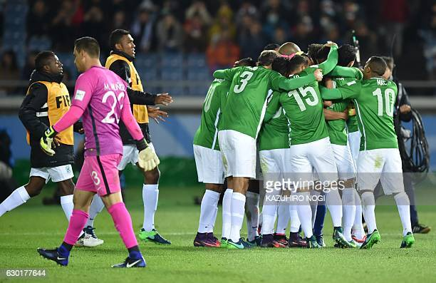 Players of Atletico Nacional celebrate their win over Club America following their penalty kick shootout at the Club World Cup thirdplace playoff...