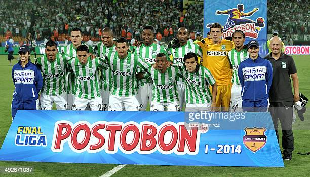Players of Atletico Nacional de Medellin pose for a photo before a second leg match between Atletico Nacional and Atletico Junior as part of Liga...