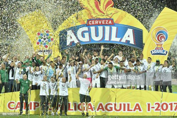 Players of Atletico Nacional lift the trophy to celebrate as champions of the Liga Aguila I 2017 after winning the Final second leg match between...