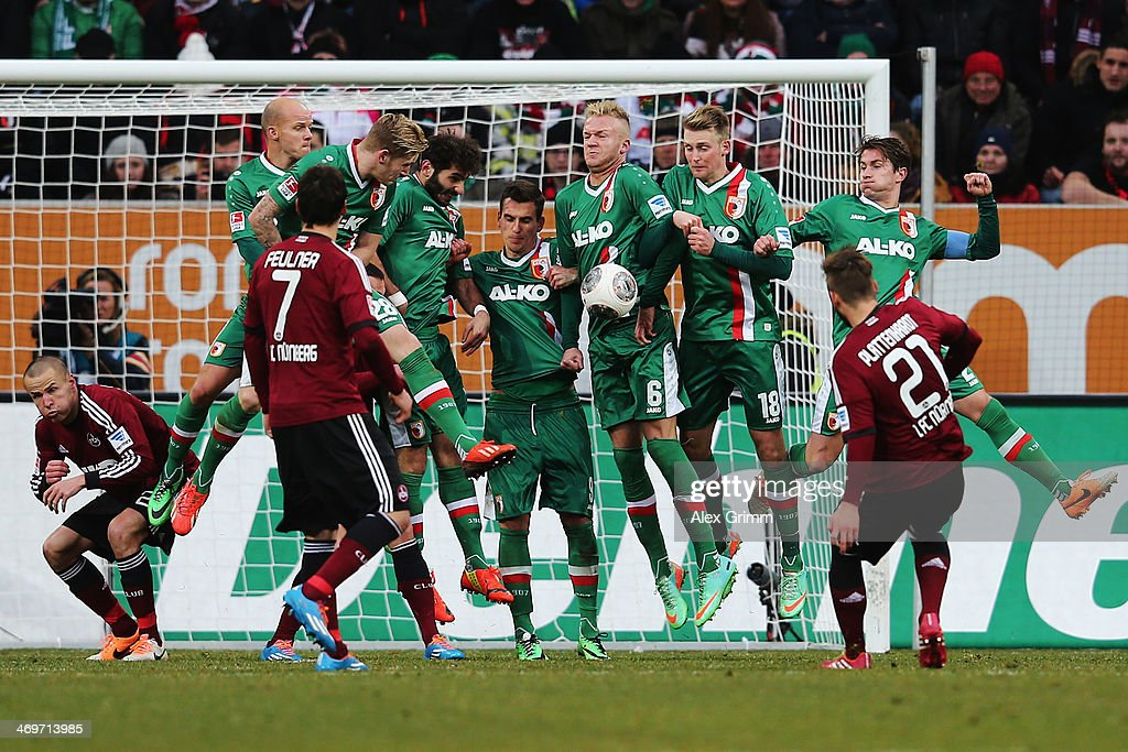Players of Augsburg block a free-kick of Marvin Plattenhardt #21 of Nuernberg during the Bundesliga match between FC Augsburg and 1. FC Nuernberg at SGL Arena on February 16, 2014 in Augsburg, Germany.