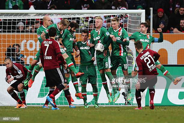 Players of Augsburg block a freekick of Marvin Plattenhardt of Nuernberg during the Bundesliga match between FC Augsburg and 1 FC Nuernberg at SGL...