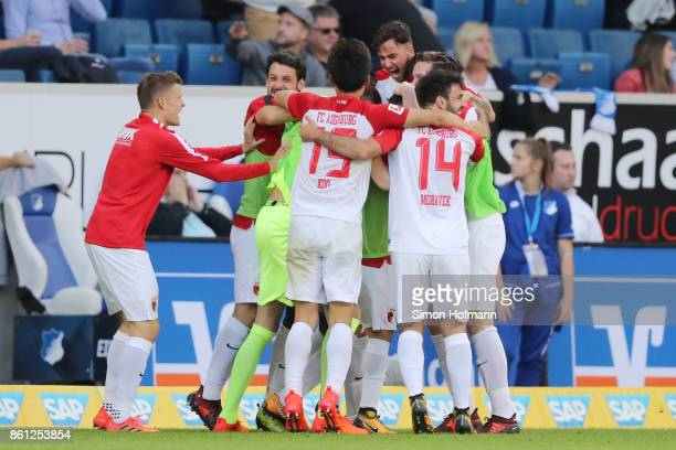 Players of Augsburg celebrate after an own goal by Kevin Vogt of Hoffenheim to make it 22 during the Bundesliga match between TSG 1899 Hoffenheim and...