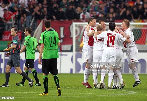 Players of Augsburg celebrate after the Second Bundesliga match between FC Augsburg and TSV 1860 Muenchen at Impuls Arena on May 2, 2010 in Augsburg,...
