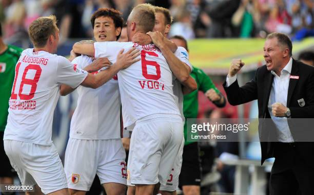Players of Augsburg celebrate the third goal during the Bundesliga match between FC Augsburg and SpVgg Greuther Fuerth at SGL Arena on May 18, 2013...