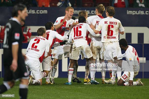 Players of Augsburg celebrate their 3rd team goal during the Second Bundesliga match between FC Augsburg and 1 FC Kaiserslautern at Impuls Arena on...