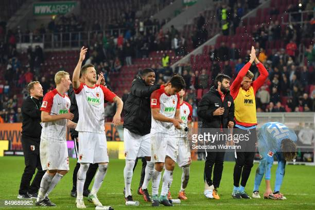 Players of Augsburg celebrate with fans after the Bundesliga match between FC Augsburg and RB Leipzig at WWKArena on September 19 2017 in Augsburg...