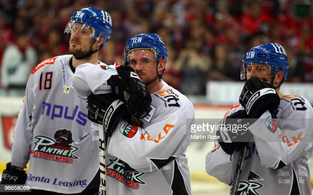 Players of Augsburg look dejected after losing the DEL play off final match between Hannover Scorpions and Augsburger Panther at TUI Arena on April...