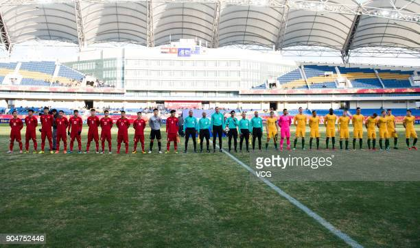 Players of Australia and Vietnam line up prior to the AFC U23 Championship Group A match between Vietnam and Australia at Kunshan Sports Center on...