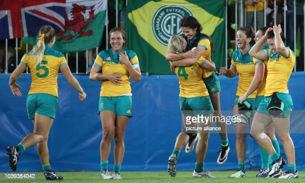 Players of Australia celebrate a try during the women's Rugby Sevens gold medal match between Australia and New Zealand at the Rio 2016 Olympic Games...