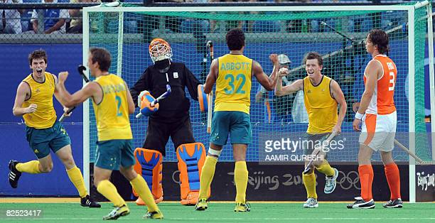 Players of Australia celebrate after scoring a goal against the Netherlands during their men's bronze medal field hockey match of the 2008 Beijing...