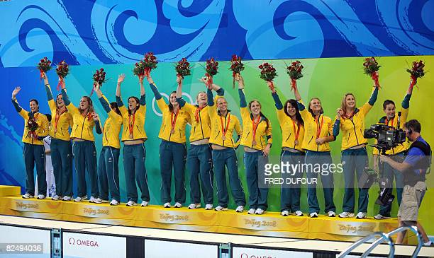 Players of Australia celebrate their bronze medal on the podium of the women's waterpolo at the 2008 Beijing Olympics Games on August 21 2008 The...