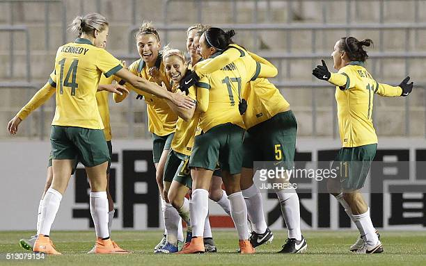 Players of Australia celebrate their third goal against Japan during their women's Asian qualifier football match for the Rio de Janeiro Olympics in...
