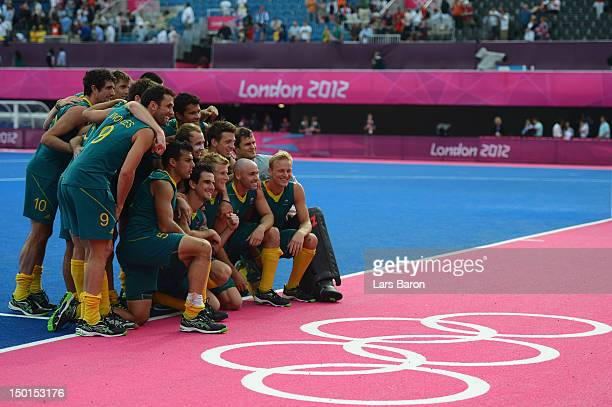 Players of Australia celebrate their victory against Great Britain and pose for a photograph after the Men's Hockey bronze medal match on Day 15 of...