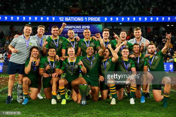 Players of Australia celebrate victory with the trophy during the Final Rugby League World Cup 9s match between Australia and New Zealand at Bankwest...