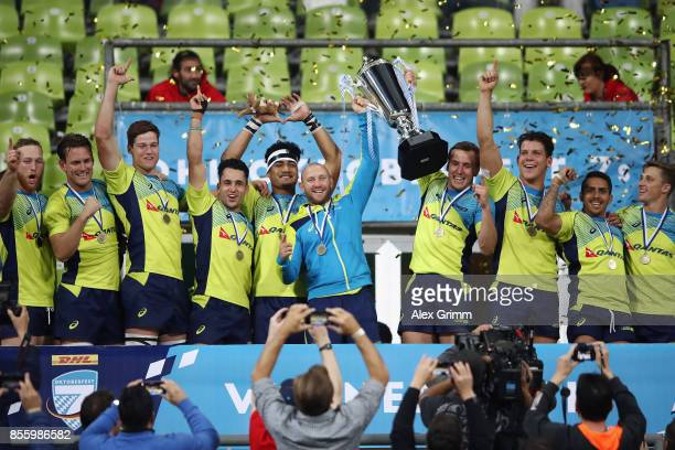 Players of Australia celebrate with the trophy after winning the final against Fiji on Day 2 of the Rugby Oktoberfest 7s tournament at Olympiastadion...