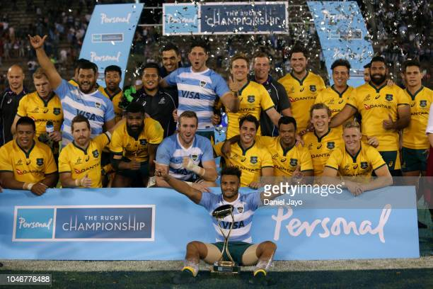 Players of Australia celebrate with the trophy at the end of a match between Argentina and Australia as part of The Rugby Championship 2018 at...