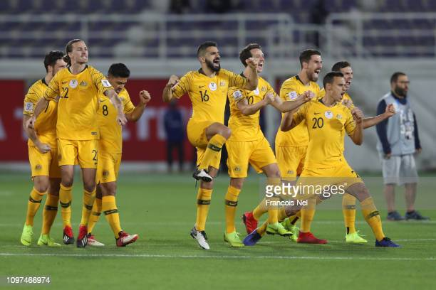 Players of Australia celebrates as Mathew Leckie of Australia scores their sides winning penalty in the penalty shoot out during the AFC Asian Cup...