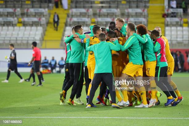 Players of Australia celebrates following their sides win after a penalty shootout in the AFC Asian Cup round of 16 match between Australia and...