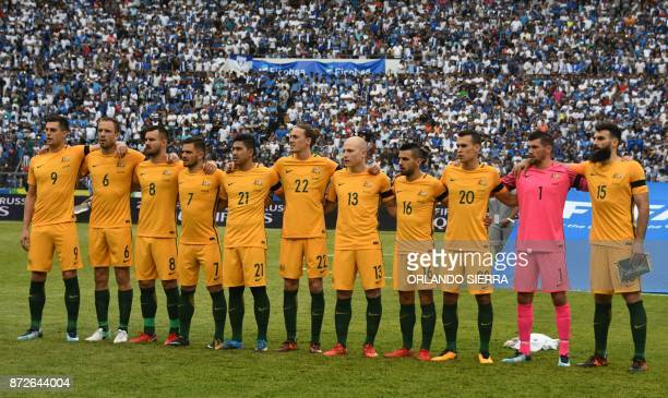 Players of Australia listen to their national anthem before the start of the first leg football match of their 2018 World Cup qualifying playoff...