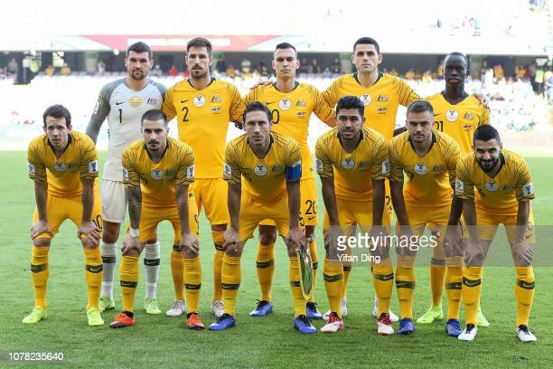 Players of Australia pose for lineup group photo prior to the AFC Asian Cup Group B match between Australia and Jordan at Hazza Bin Zayed Stadium on...