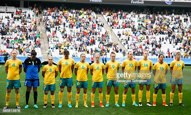 Players of Australia stand in line for the national anthen before the match between Canada and Australia womens football for the summer olympics at...