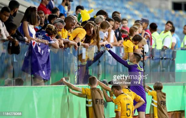 Players of Australia talk to their fans after the FIFA U17 World Cup Brazil 2019 Group B match between Australia and Hungary at Estadio Olimpico de...