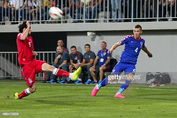 Players of Azerbaijan in red uniform during the EURO 2016 Group H qualifier match between Croatia in blue uniform at the Bakcell arena stadium in Baku