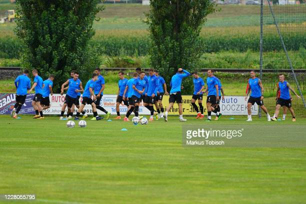 Players of Banik Ostrava warm up during the Friendly match between TSV prolactal Hartberg and FC Banik Ostrava at RM-Stadion on August 15, 2020 in...