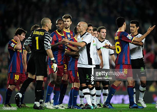 Players of Barcelona and Valencia argue during the La Liga match between Barcelona and Valencia at the Camp Nou stadium on October 16 2010 in...