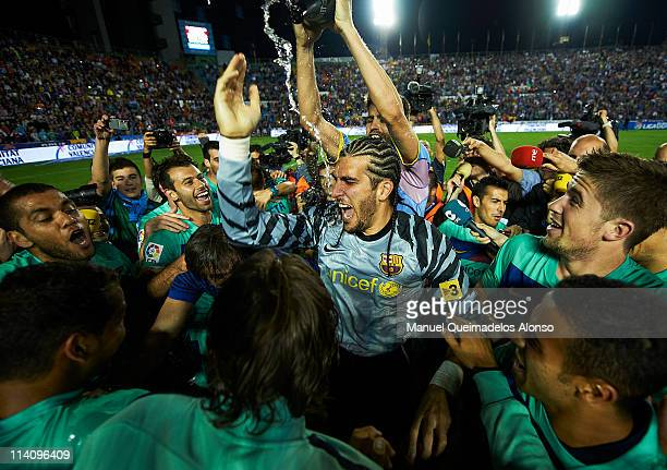 players of Barcelona celebrate after the La Liga match between Levante UD and Barcelona at Ciutat de Valencia on May 11 2011 in Valencia Spain The...