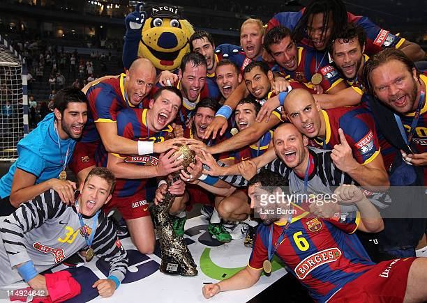 Players of Barcelona celebrates with the cupm after winning the EHF Final Four final match between FC Barcelona Borges and Ciudad Real at Lanxess...