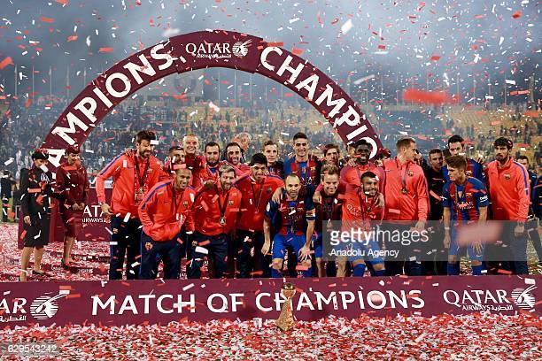 Players of Barcelona pose for a group photo after winning the friendly soccer match between Al-Ahli Saudi and Barcelona at Al-Gharrafa Stadium in...