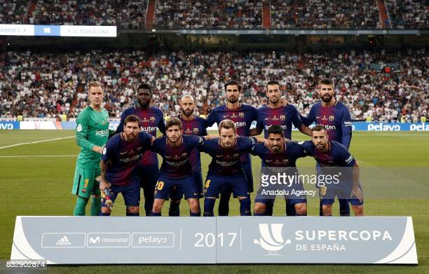 Players of Barcelona pose for a photo ahead of the Spanish Super Cup return match between Real Madrid and Barcelona at Santiago Bernabeu Stadium in...