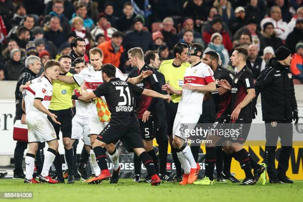 Players of Bayer Leverkusen and VfB Stuttgart argue during the Bundesliga match between VfB Stuttgart and Bayer 04 Leverkusen at MercedesBenz Arena...