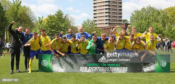 Players of Bayern celebrate after winning the U16 Juniors Federal Cup at Sportschule Wedau on May 9 2017 in Duisburg Germany