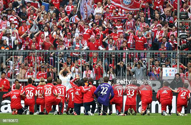 Players of Bayern celebrate their victory with fans after the Bundesliga match between FC Bayern Muenchen and VfL Bochum at Allianz Arena on May 1...